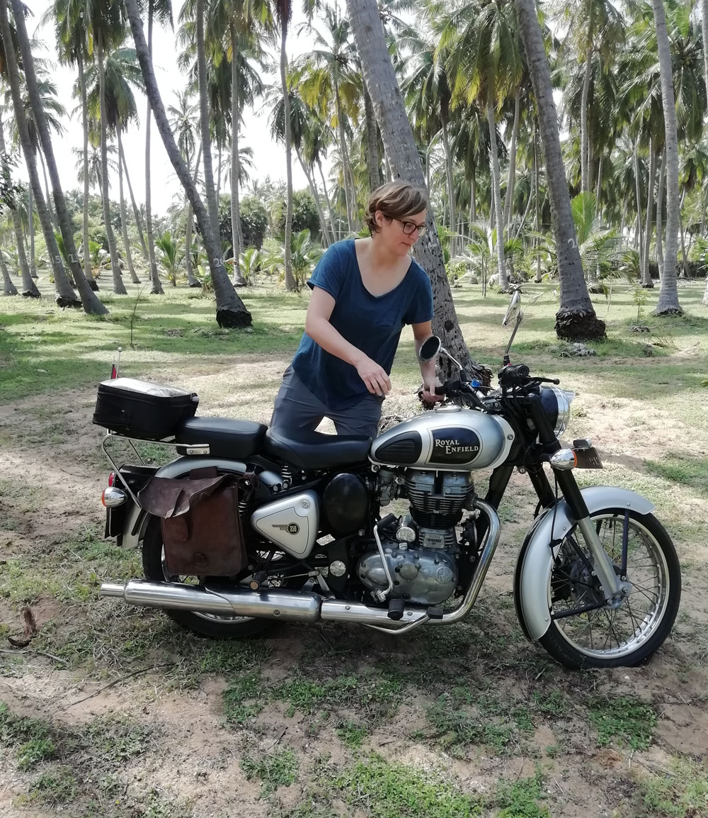 Woman on Royal Enfield motorcycle